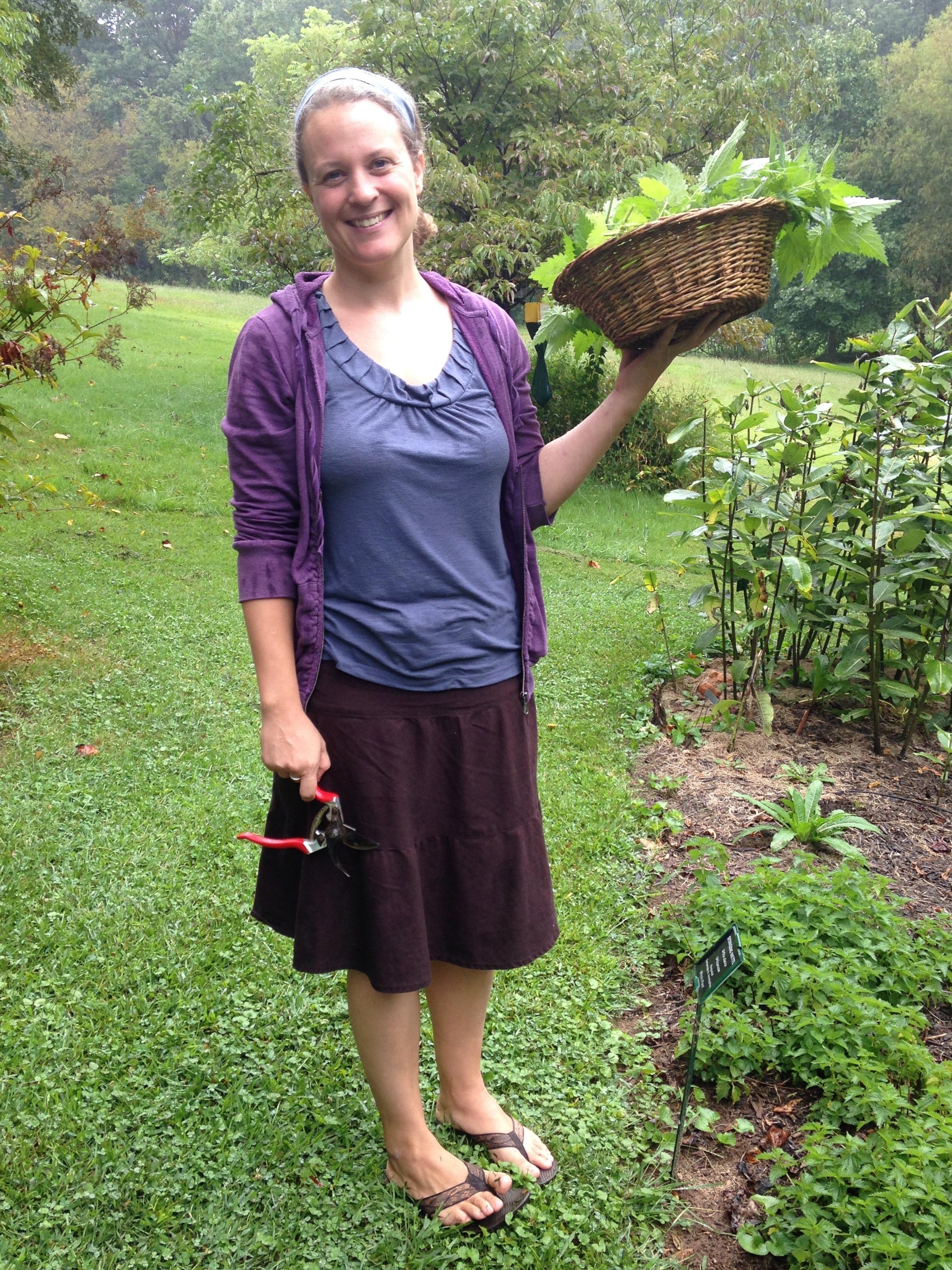 Camille harvesting nettles in the rain