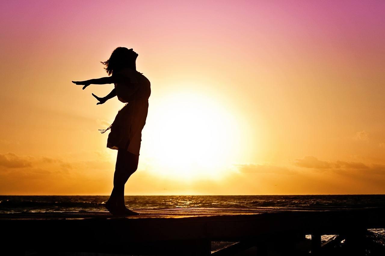 woman on beach. very free.