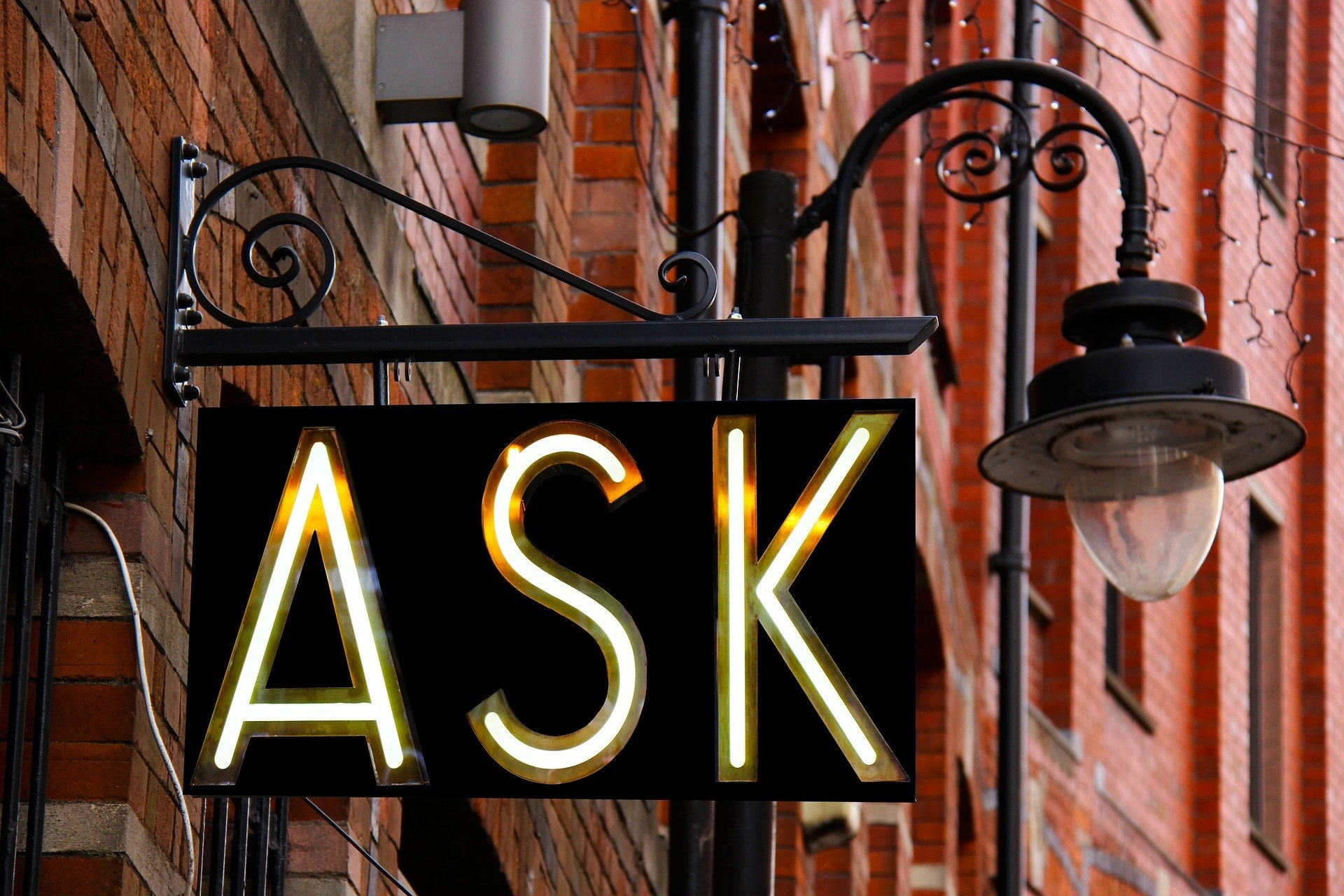 "sign stating ""ask"""