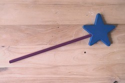 magic wand on wooden desk