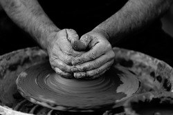 hands throwing pottery